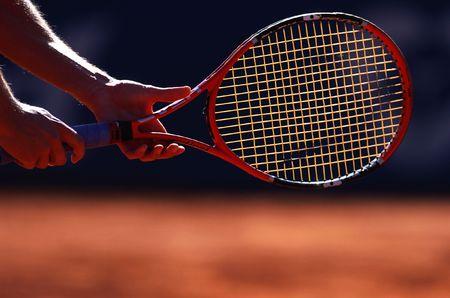 tennis racket: man holding tennis racket