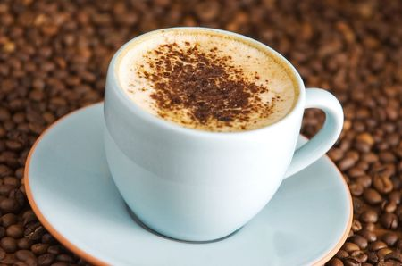 capuccino: cappuccino on table with coffee beans Stock Photo