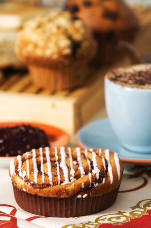 cakes on table with cup of coffee photo