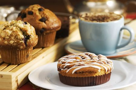 coffee cakes on table with cup of coffee