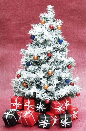 christmas tree isolated on red background photo