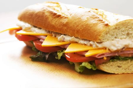tuna sandwich with lettuce and tomato