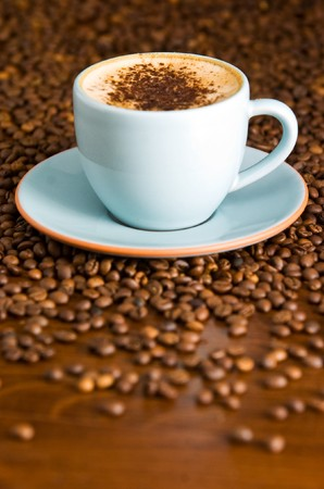 cappuccino on table with coffee beans Stockfoto