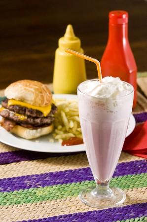 Cheeseburger with fries and strawberry milkshake photo