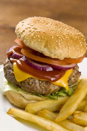Cheeseburger with ketchup and french fries photo