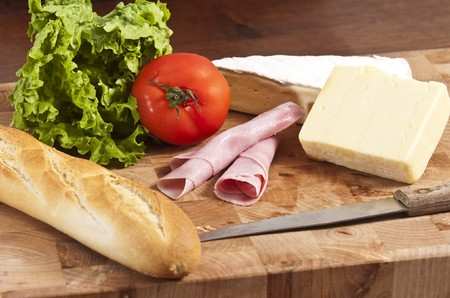 rustic french baguete with ham and cheese photo