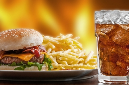 Cheeseburger with fries and icy soft drink
