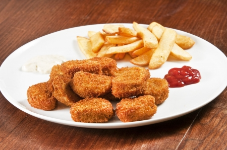 french fries plate: Chicken nuggets on white plate with ketchup and french fries Stock Photo