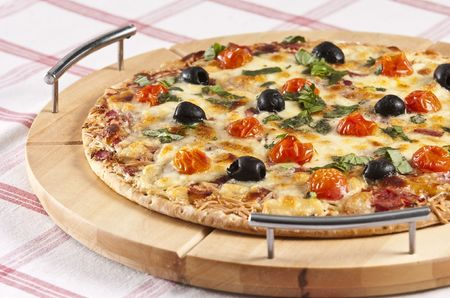 baked pizza served on wooden board