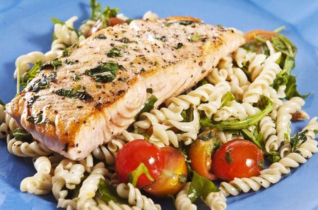 seasoned: grilled salmon on blue plate with tomato and arugula pasta salad