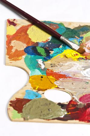 Detail of a paintbrush on an artists palette photo