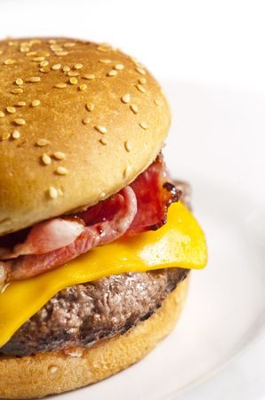 Cheeseburger with bacon on white plate