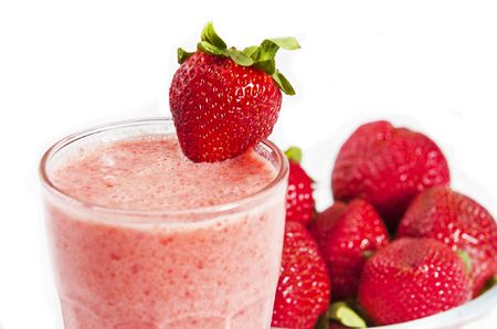 fruit shake: glass of freshly made strawberry smoothie