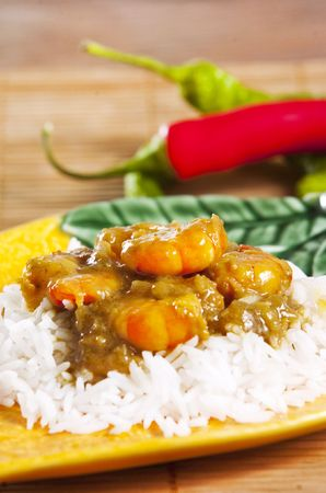 Prawn curry served  with basmati rice  photo