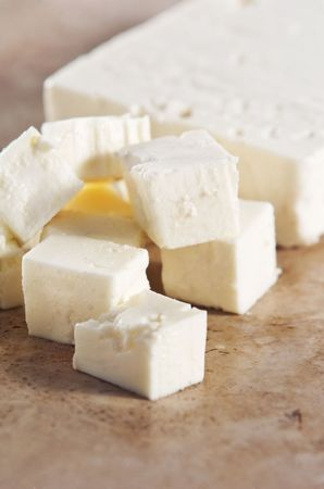 cubed: Cubed feta cheese on a kitchen counter
