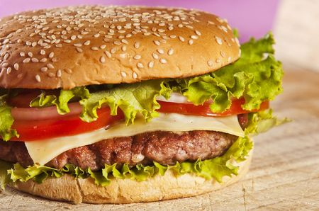 Cheeseburger with onions tomato and ketchup photo