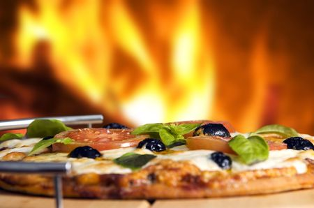 Oven baked pizza served on wooden board