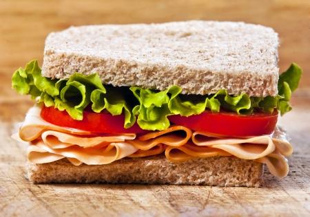 deli meat: Turkey sandwich with lettuce and tomato