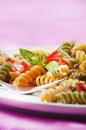 primavera: Pasta primavera garnished with basil leaves