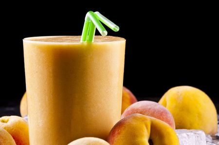 A glass of freshly made peach smoothie