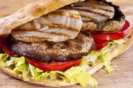 Portobello sandwich with grilled onion lettuce and tomato