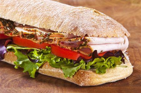 deli meat: panini sandwich with lettuce tomato and turkey Stock Photo