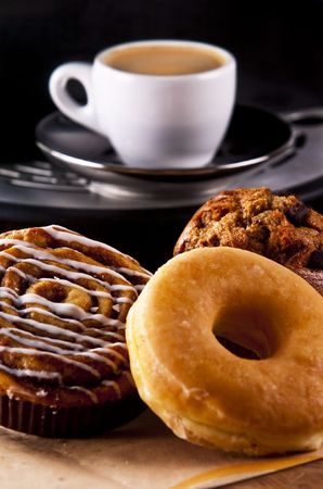 Fresh doughnut and cookies with an espresso Imagens