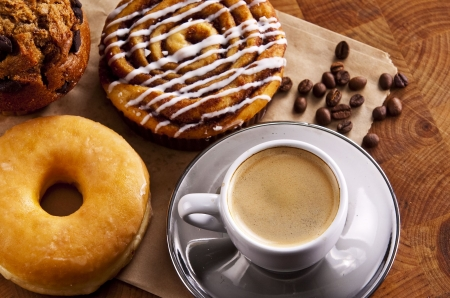 Fresh doughnut and cookies with an espresso photo