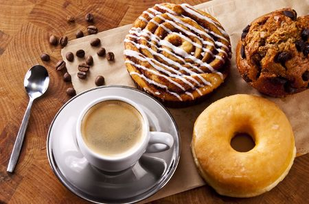 muffins: Fresh doughnut and cookies with an espresso Stock Photo