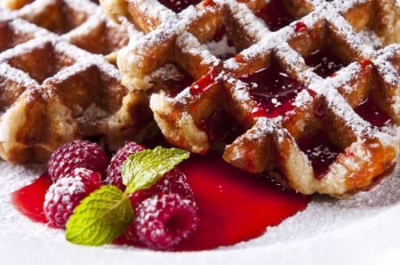 waffles: Delicious Belgian waffles garnished with fresh raspberries