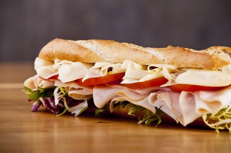 Turkey sandwich with cheese lettuce and tomato