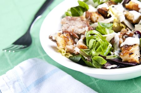 salad dressing: Delicious chicken caesar salad with tasty dressing