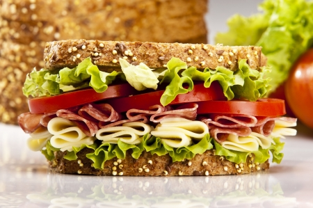 ham sandwich: Salami sandwich with cheese lettuce and tomato Stock Photo