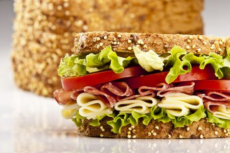 deli meat: Salami sandwich with cheese lettuce and tomato Stock Photo