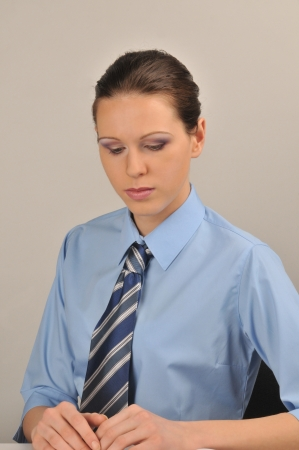 Serious girl, dressed in business clothing photo
