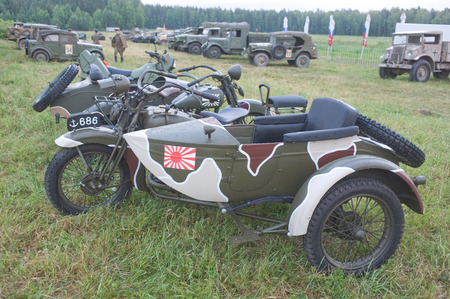 original bike: CHERNOGOLOVKA, MOSCOW REGION, RUSSIA -JUNE 21, 2013:  Japanese old military Rikuo motorcycle Type 97 (a copy of the Harley-Davidson) at the 3rd international meeting of \Motors of war\ near the city Chernogolovka, side view