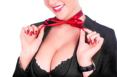 big breast: A beautiful sexy gril in a black anderwear with a red bow on her neck (isolated on white)