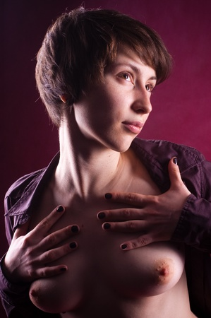 woman nude in studio with red background Stock Photo