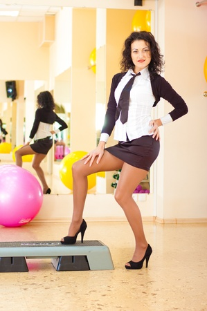 sucsess woman in fitness gym photo