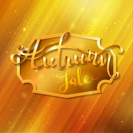 Golden autumn background. Golden badge in the center and golden words Autumn sale on it. Word Autumn is written from ribbon.