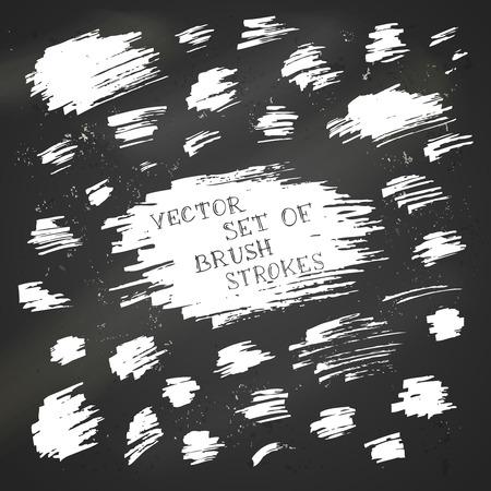 brush stroke: Set of vector chalk brush strokes. Various white flourishes on blackboard background.