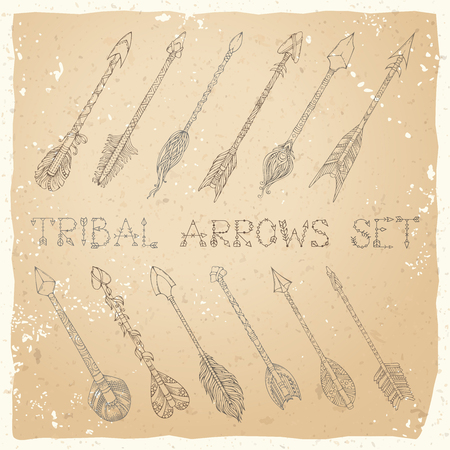 intention: Vector set of sepia ethnic arrows on old paper background. Hand-drawn sepia tribal decorative elements in boho style. Tattoo design. Illustration