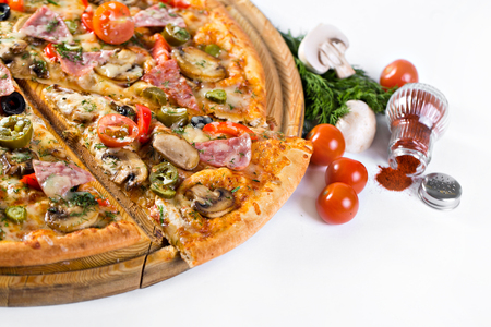 served: Delicious italian pizza served on wooden table. Stock Photo