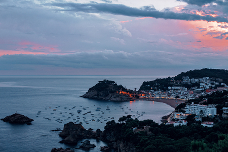 Buch sea with boats the famous Village of Tossa de Mar on the Costa Brava at Night,Catalonia,Spain.