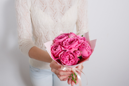 A small bouquet of roses in hands Peony- girl Florist