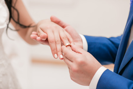 rite: the groom and the bride hold each other by hands. Stock Photo