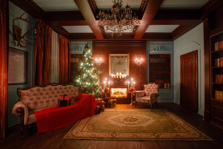 Calm image of interior Classic New Year Tree decorated in a room with a fireplace