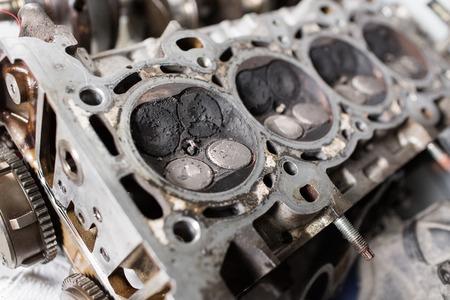 Engine valve car maintenance. A deposit on a piston, a large run a long service life Stock Photo