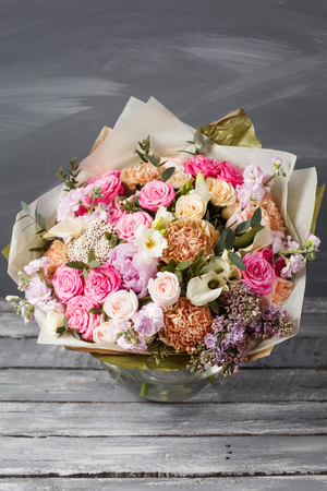 precast: Vintage dark grunge wood texture with empty space decorating by old rose and mixed flowers sweet romantic concept