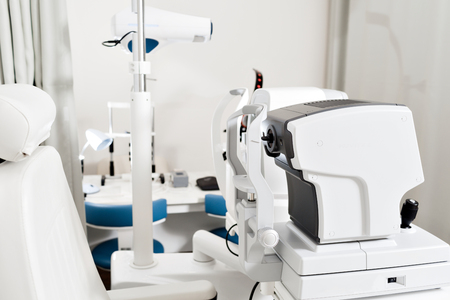 Close up of professional eye testing equipment. Modern eye testing device standing in the lab. Tonometer in ophthalmologists office